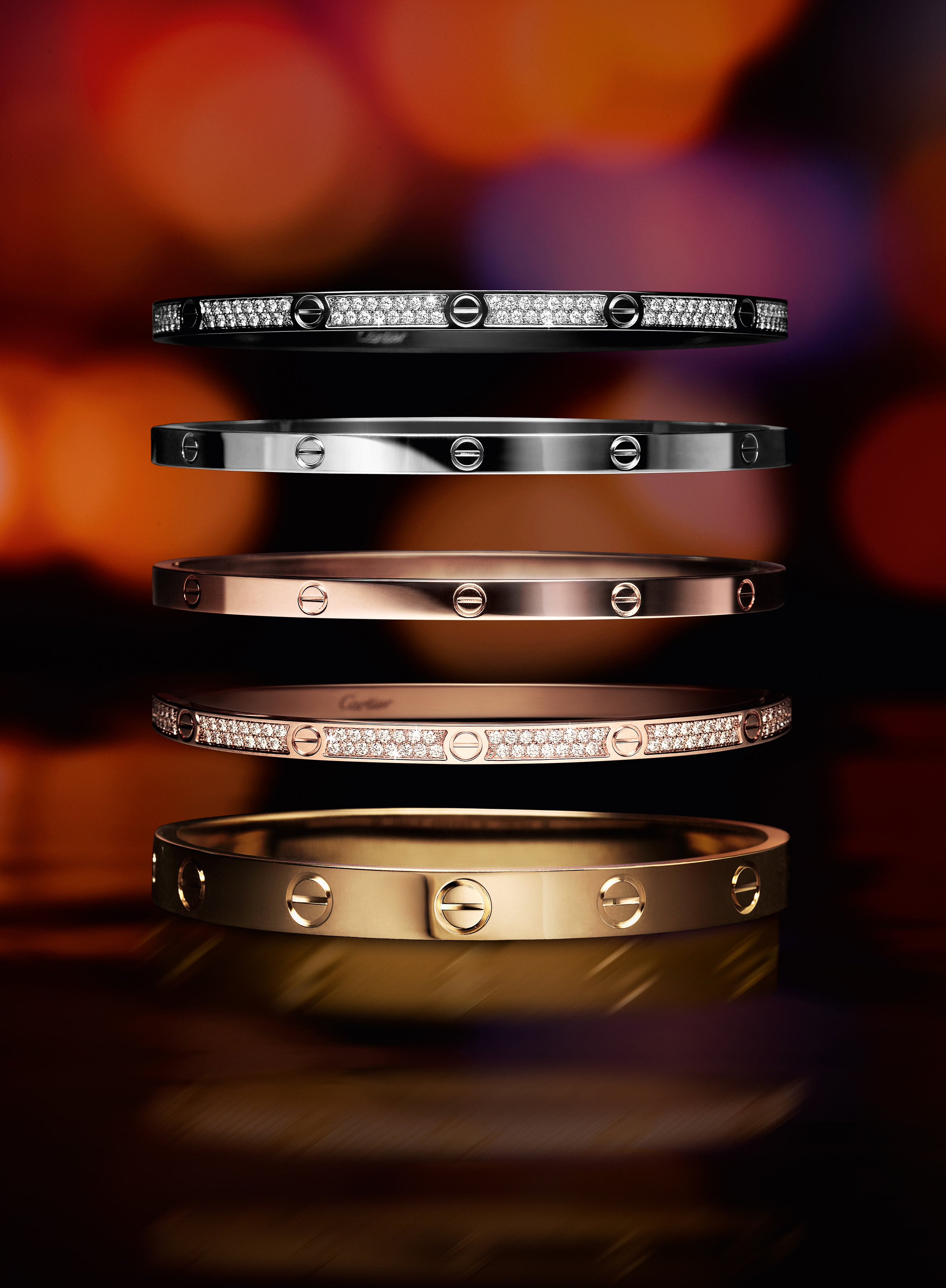 Five Cartier Love braclets on rose, yellow and white gold