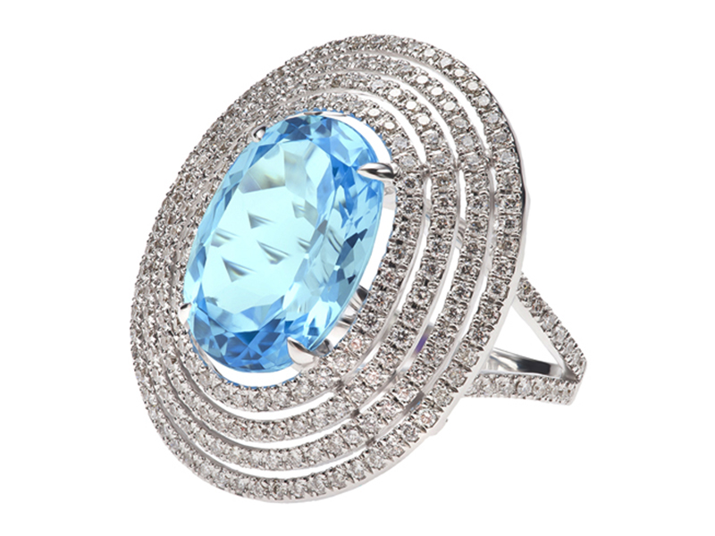 3- Etername: Bague Soleil A Blue topaz stone is often associated with courage, favoring loyalty, friendship sweetness and integrity, a blue topaz calms mental anxiety. Described as the sun-shape ring, the central stone is surrounded by four oval rows of diamonds.