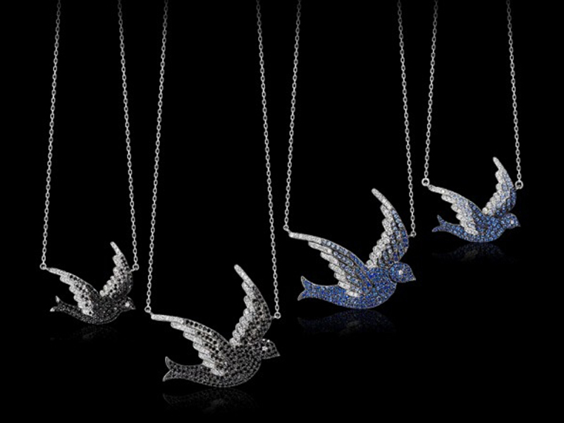1- AS29 From the Pave Bird Collection, the pendants are mounted on white gold and set with white diamonds and blue sapphires. ~ 2'500 Euros.