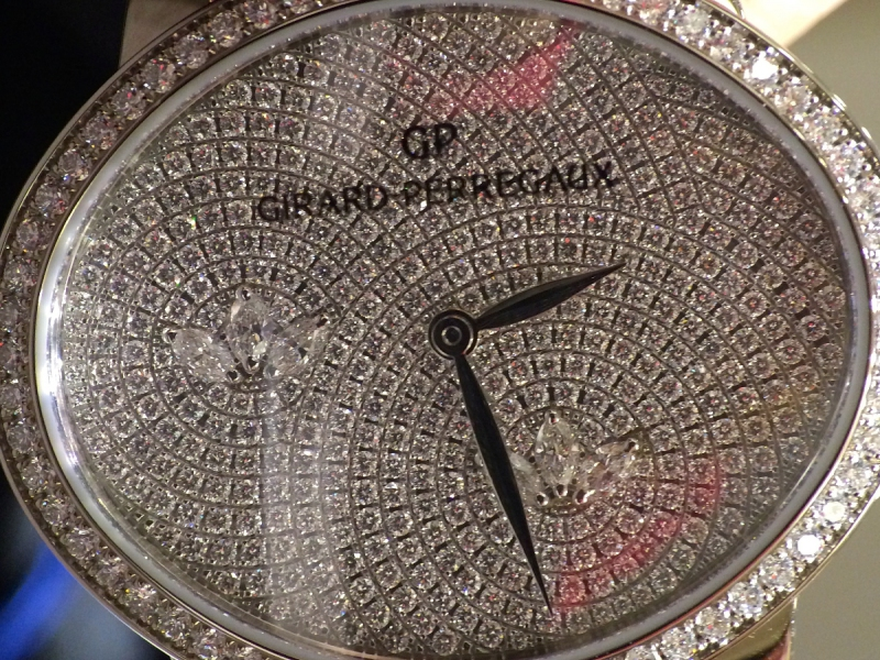 5- Girard-Perregaux set trios of marquise diamonds within the full-diamond paved dial of the new cat's eye.