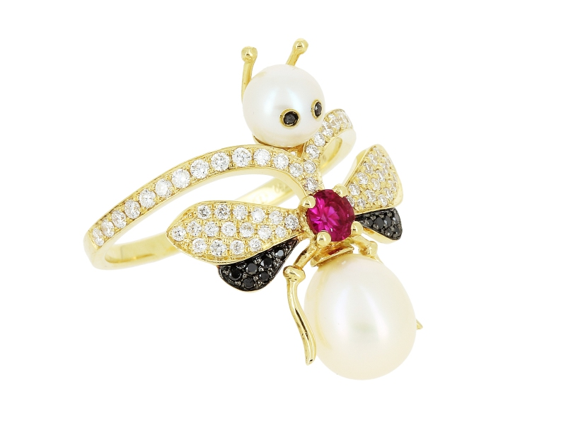 Yvonne Leon Bee Ring set on yellow gold with black and white diamonds, a ruby heart and two white pearls