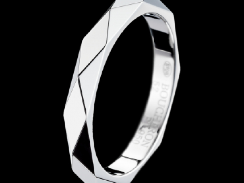 Boucheron - Facette Platinum wedding band The platinum wedding band is sculpted, cut then polished to re-create the multiple facettes of a diamond.