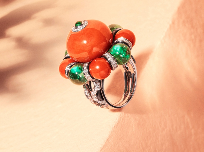 Cartier Flamboyant Ring - Set in platinum, one 30.19-carat coral bead, four coral beads totalling 13.47 carats, four emerald beads from Zambia totalling 14.28 carats, cabochon-cut emerald, onyx, black lacquer, brilliant- cut diamonds. Etourdissant Collection