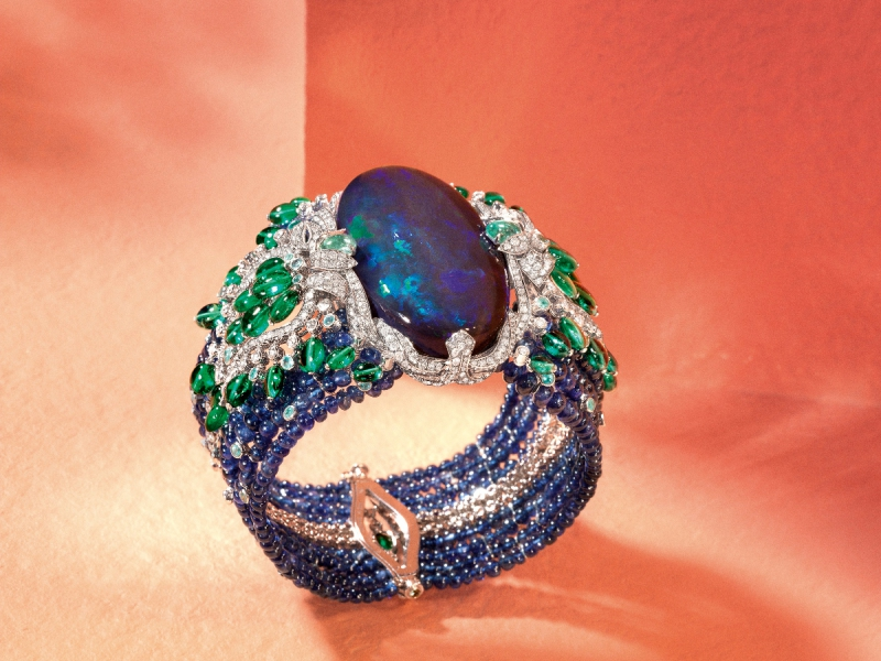 Cartier Lagon Bracelet set in platinum, one 85.42-carat oval- shaped cabochon-cut black opal, sapphire beads, emerald long beads, Paraiba tourmalines, brilliant- cut diamonds. Etourdissant Collection