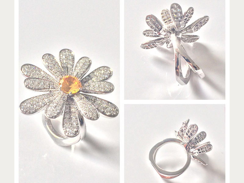 A yellow sapphire of 1.30 carats with petals set with 162 diamonds (1.89 carats) and mounted on white gold ( ~ 28'000 Euros)