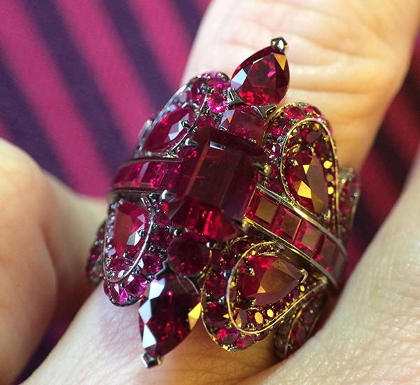 John Rubel Louise Ring fully paved with Rubies and gold diamonds on the inside of the ring.