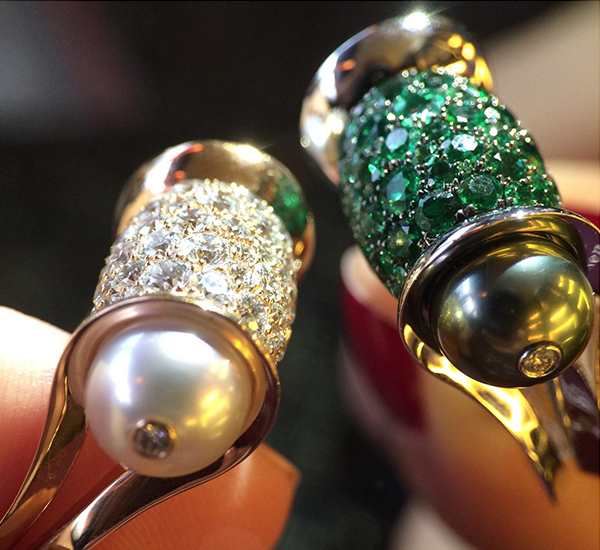 John Rubel Ginger Rings. On the left - white diamonds with white pearls On the right emeralds with black pearls.