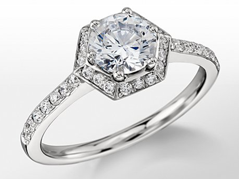 6- Monique Lhuillier : The Hexagon Halo Engagement Ring. Forever timeless, this luxurious platinum engagement ring showcases an hexagon halo of pavé-set diamonds that accents its graceful aesthetic. ( ~ 2,200 Euros)