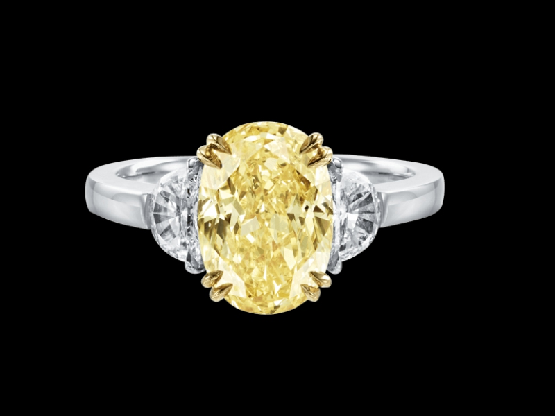 Harry Winston yellow diamond engagement ring mounted on platinum