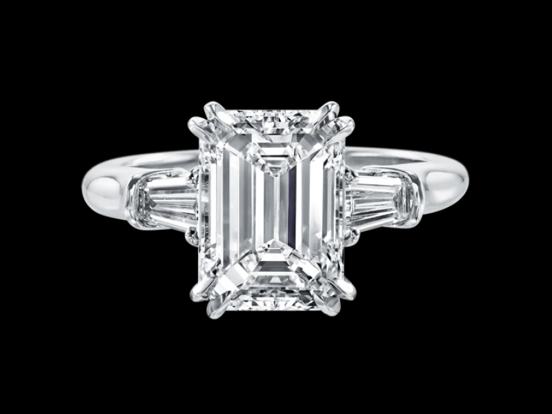 Harry Winston engagement ring mounted on platinum with diamond