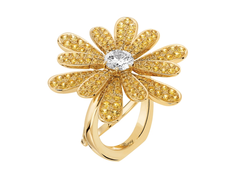 Poiray Flower Poiray set with a central diamond and yellow sapphires moving petals