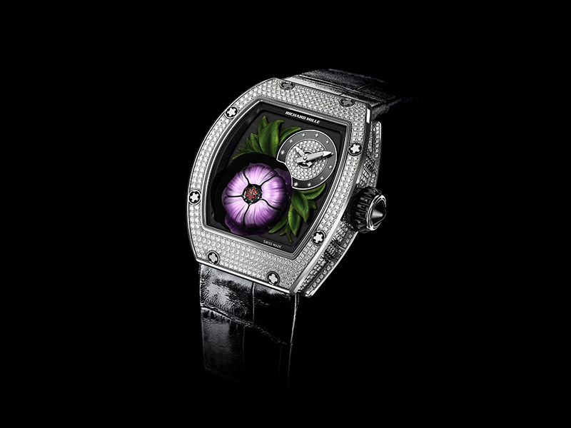 Audemars Piguet  The Millenary Tourbillon with the off-centered fully diamond paved flower and a transparency of the case allowing the whole appearing mechanism to breathe.