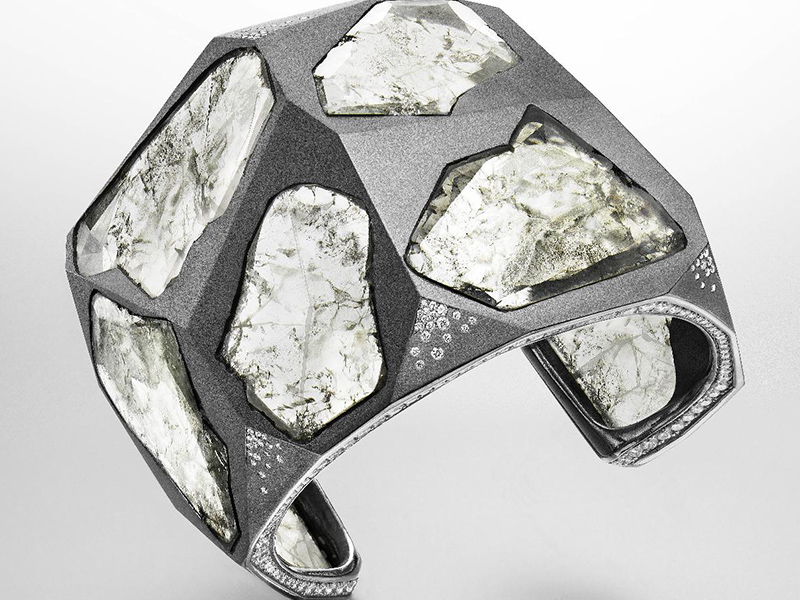 the big bang bracelet in titanium and gold set with: 9 Diamond Slices 115.32 cts 336 Diamonds 5.82 cts Suzanne Syz