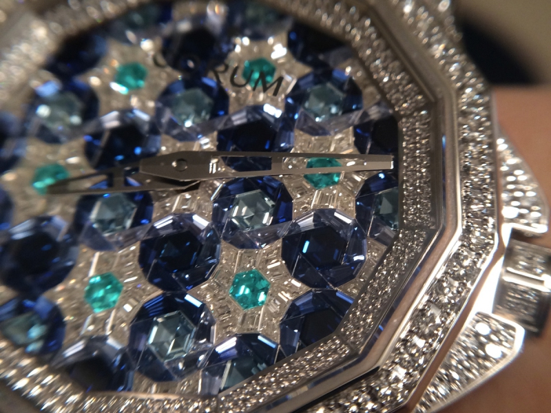 Corum set their Amiral Cup timepiece with diamonds, sapphires and parraiba stones – a wow effect in work and color combination.