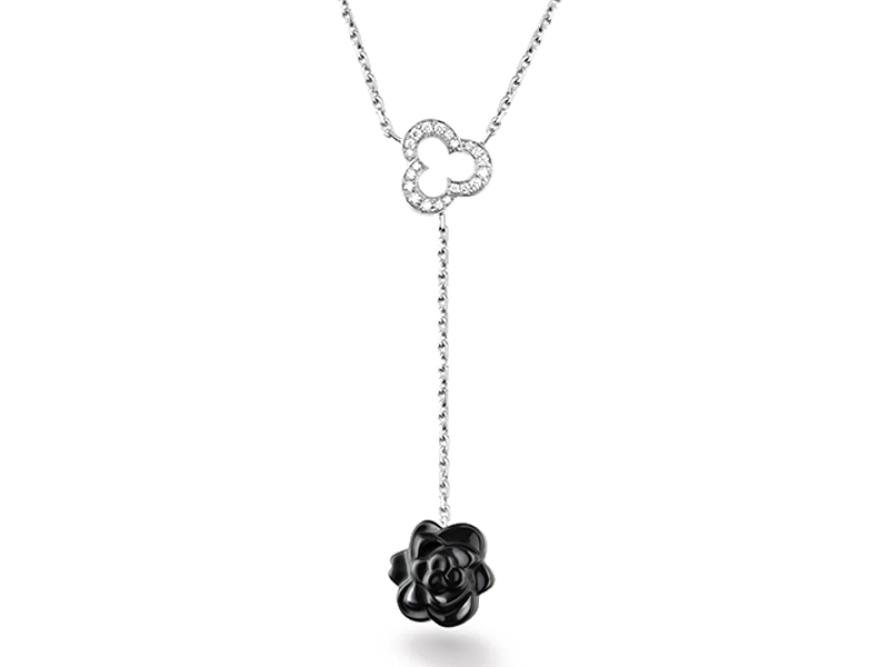 Camélia Necklace by Chanel sculpté in black onyx, 18k white gold and diamonds