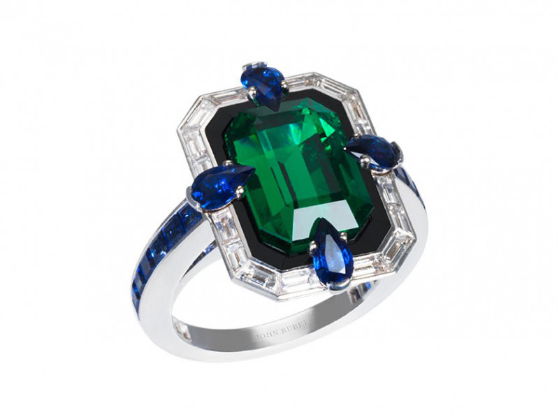 John Rubel Liberty ring mounted on grey gold with emerald, diamonds, sapphire and ony. This ring is available at the Pop Up