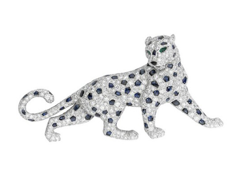Cartier Panther brooch mounted on platinum with diamonds, emeralds and saphhires