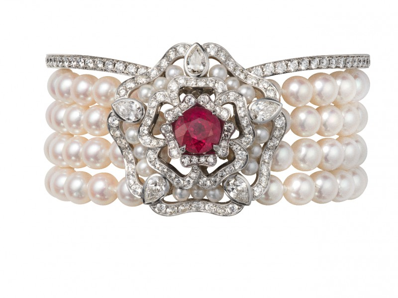 Garrard Bracelet mounted on white gold with white pearls and a ruby surrounded by white diamonds