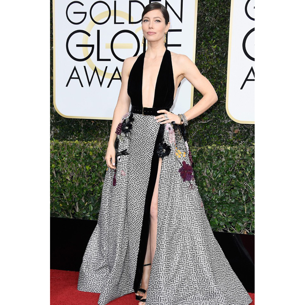 Neil Lane Jessica Biel wore Gold Elongated Foliate Earrings, Garnet, Gold and Diamond Twisted Cross Over Bangle Bracelet, Gold, Diamond and Pearl Wide Lattice Bracelet, Diamond, Ruby and Gold Tois et Mois Ring, Diamond and Twisted Gold Ring, Diamond and Gold Nevette Ring and a Diamond and Gold 5 Stone Ring