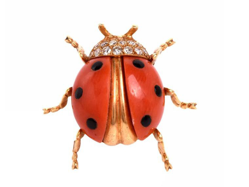 Tiffany & Co Ladybug brooch mounted on gold with salmon-colored coral, black spots and diamonds