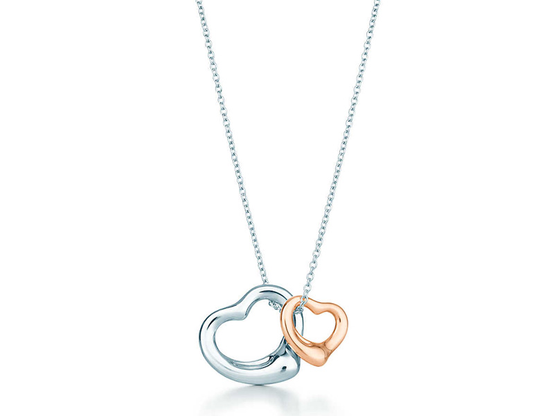 2281b8b37b30 Tiffany   Co. - Open Heart pendant mounted on sterling silver and 18K rose  gold