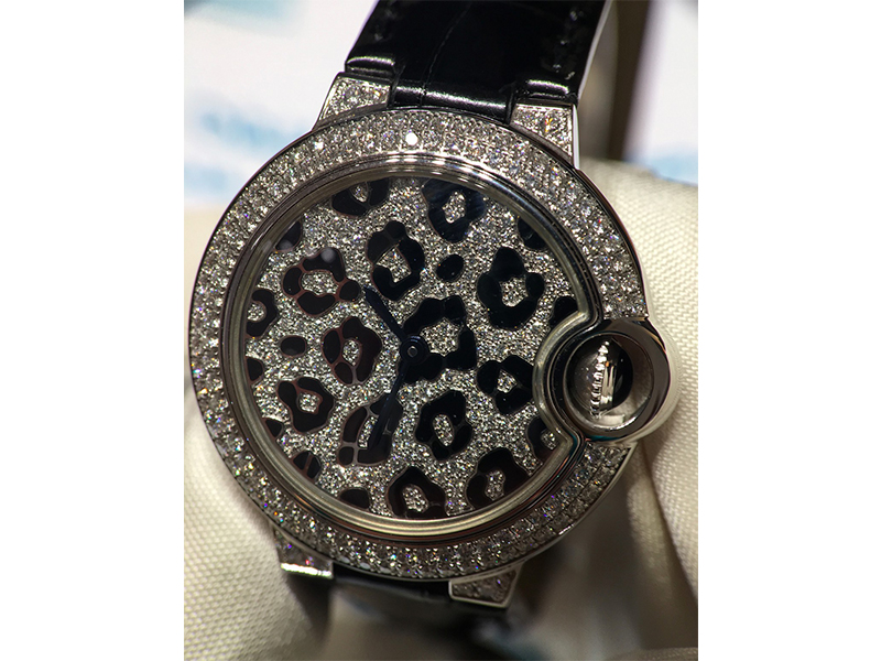 Cartier watch with diamonds for woman