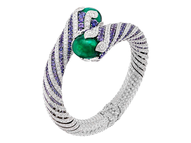 Van Cleef & Arpels Twist émeraude bracelet mounted on white gold, round diamonds, round mauve sapphires, 2 cabochon-cut emeralds of 19.80 and 21.48 carats (Colombia).