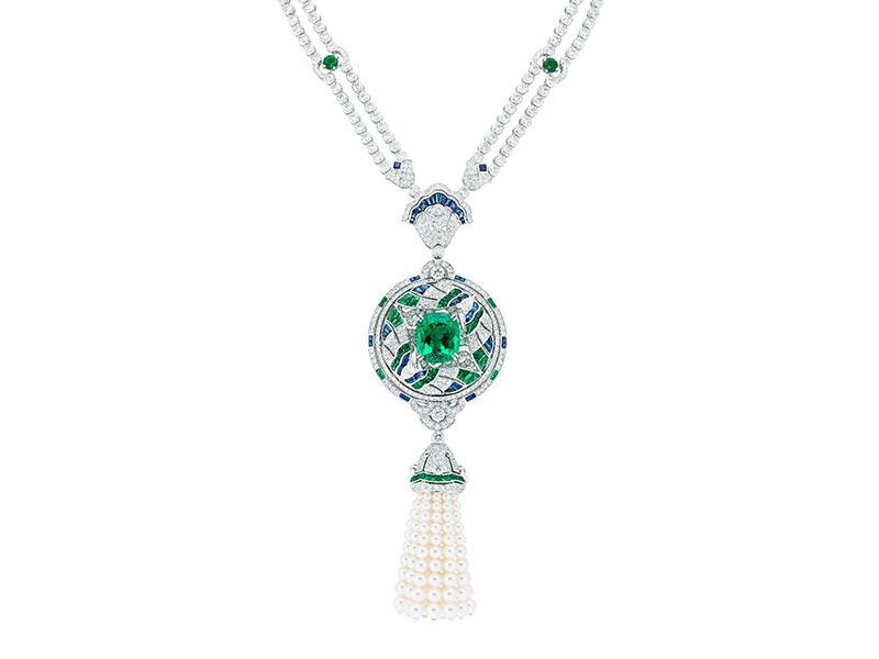 Van Cleef & Arpels Talisman papillons necklace mounted on white gold, round diamonds, square-cut, faceted and buff-topped baguette-cut sapphires, round, square-cut, faceted and buff-topped baguette-cut emeralds, white cultured pearls, one cushion-cut emerald of 16.52 carats (Colombia). Detachable clip and tassel.