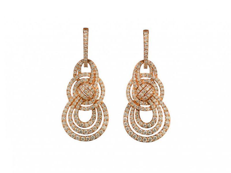 Garrard From Entanglement collection - a pair of rose gold earrings set with white diamonds