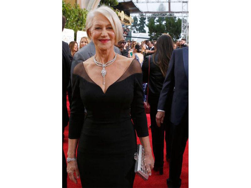 Helen Mirren Wears Harry Winston's Secret collection with a Secret Cluster Diamond Necklace set with 83.72 carats of diamonds on platinum; a Secret Cluster Diamond Bracelet of 19.58 carats and Winston Cluster Diamond Earrings worth 12 carats.