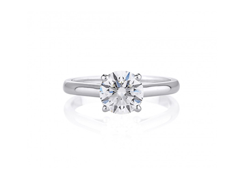 DeBeers Classic Solitaire Ring mounted on white gold with a round center diamond.