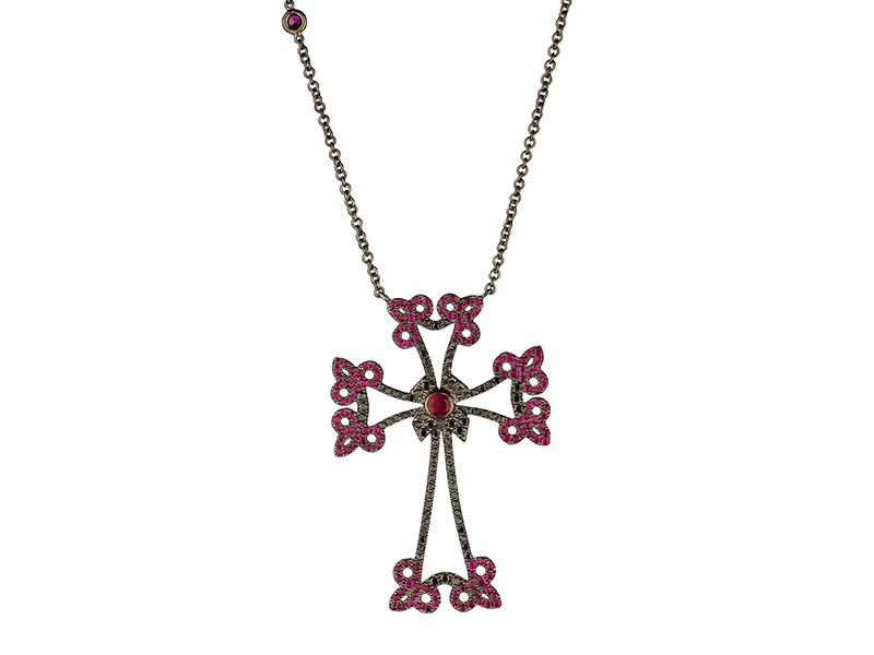 Laura Sayan Arev cross diamants mounted on black gold with rubies and black diamonds. Available at the Pop Up, CHF 4'110