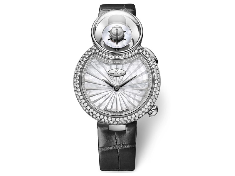 Jaquet Droz White mother-of-pearl dial. 18-carat white gold case set with 114 diamonds, ring set with 88 diamonds, buckle set with 21 diamonds, total of 1.57 carat. Mechanical opening flower automaton movement.