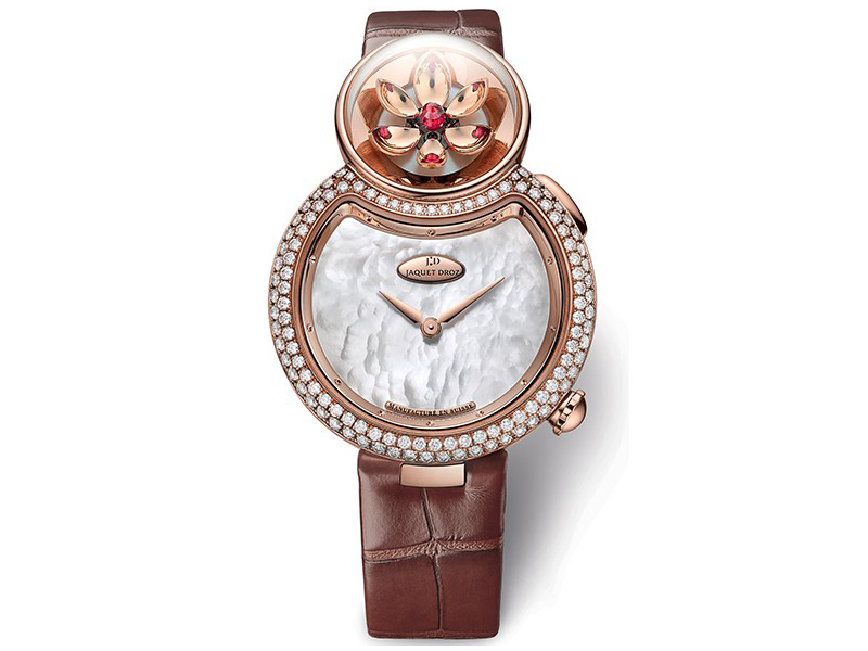 Jaquet Droz White mother-of-pearl dial. 18-carat red gold case set with 114 diamonds, buckle set with 21 diamonds, total of 1.65 carat. 18-carat red gold ring. Mechanical opening flower automaton movement.