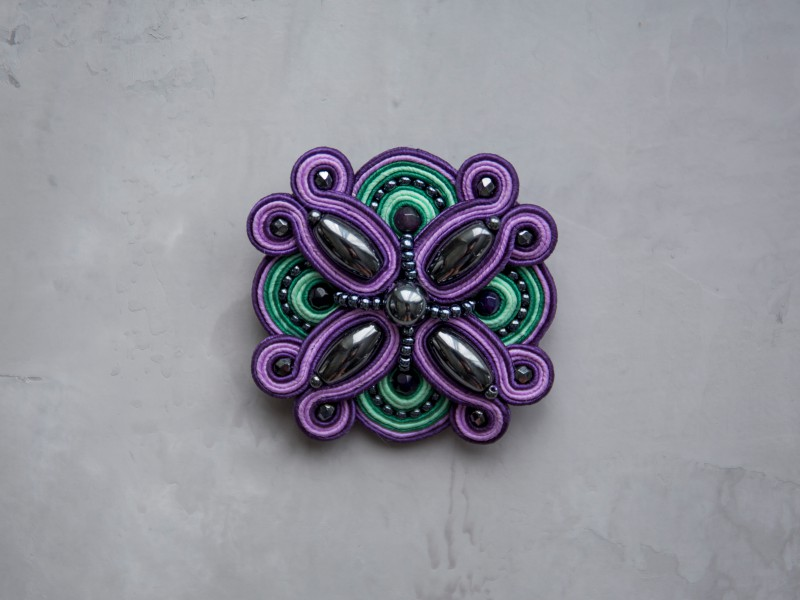Nowness Lakshmi Purple-Green - Swarovski brooch is available at the Pop Up, ~ CHF 167