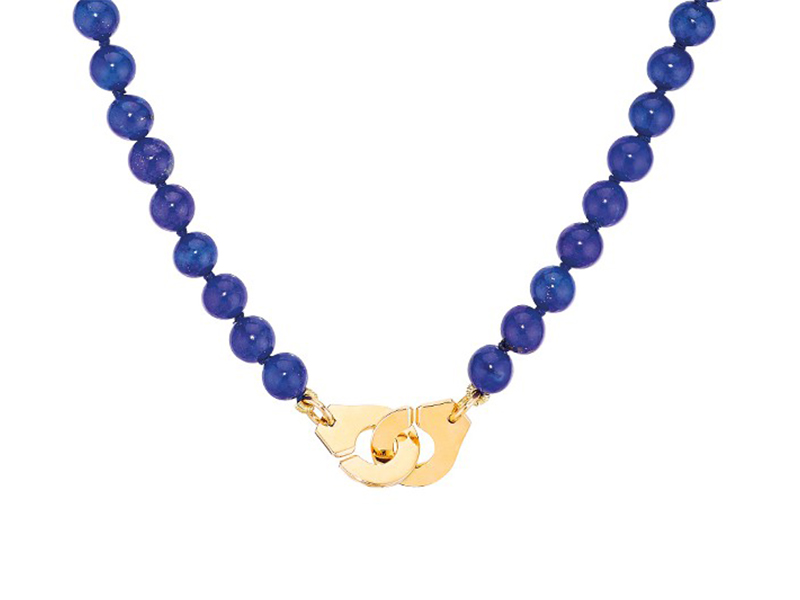 Dinh Van Menottes necklace mounted on yellow gold with lapis lazuli