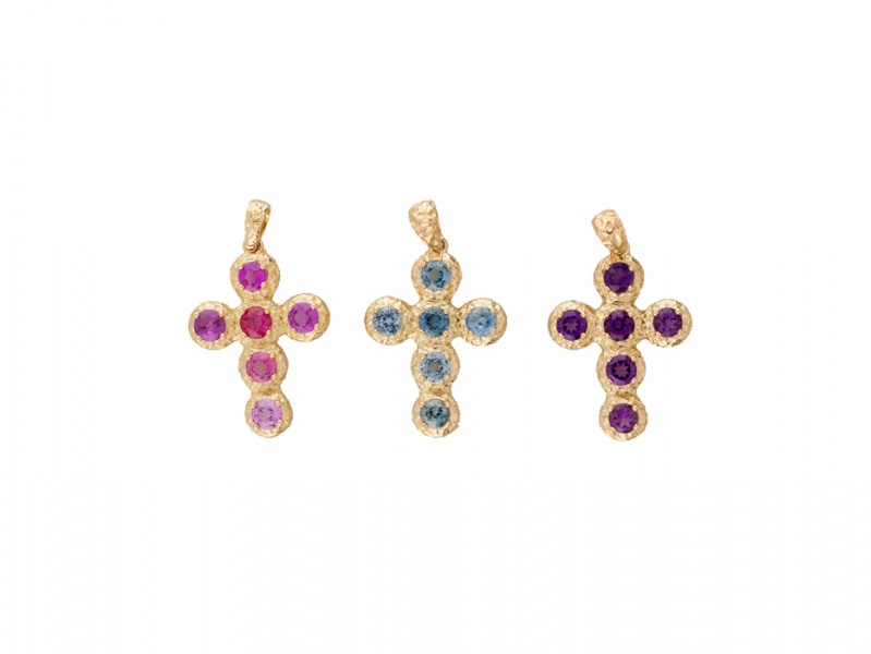 Aude Lechere These cross pendants (rose saphir, blue saphir, amethyst) mounted on yellow gold are available at the Pop Up - CHF 1'935