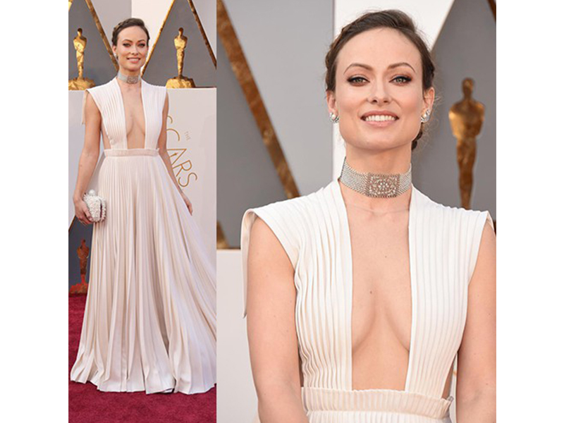 Neil Lane Olivia Wilde wore Neil Lane Edwardian, pearl, diamond and platinum choker, half moon diamond, pearl and platinum earrings and a large diamond and platinum navette ring. Oscars 2016