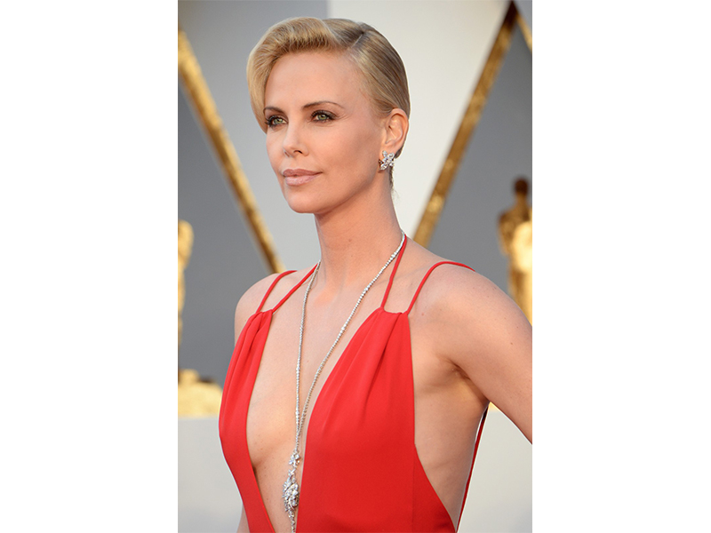 Harry Winston Charlize Theron wore a Secret Cluster diamond necklace with Winston Cluster diamond earrings oscars 2016