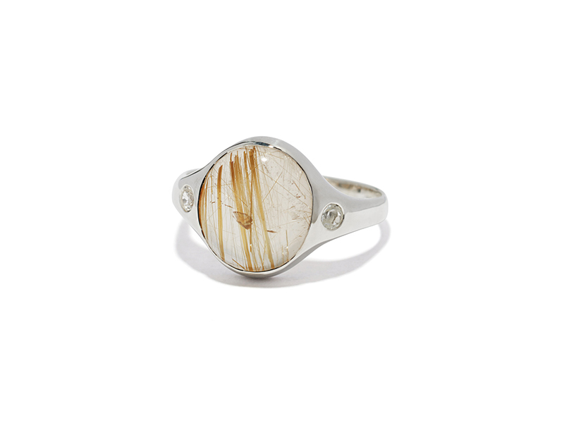 Pamela Love Essential ring mounted on sterling silver with rutilated quartz and white topa, ~ USD$ 210