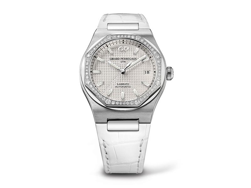 Girard Perregaux Laureato in steel with bezel paved with diamond. Mounted on an aligator bracelet with a folding clap.