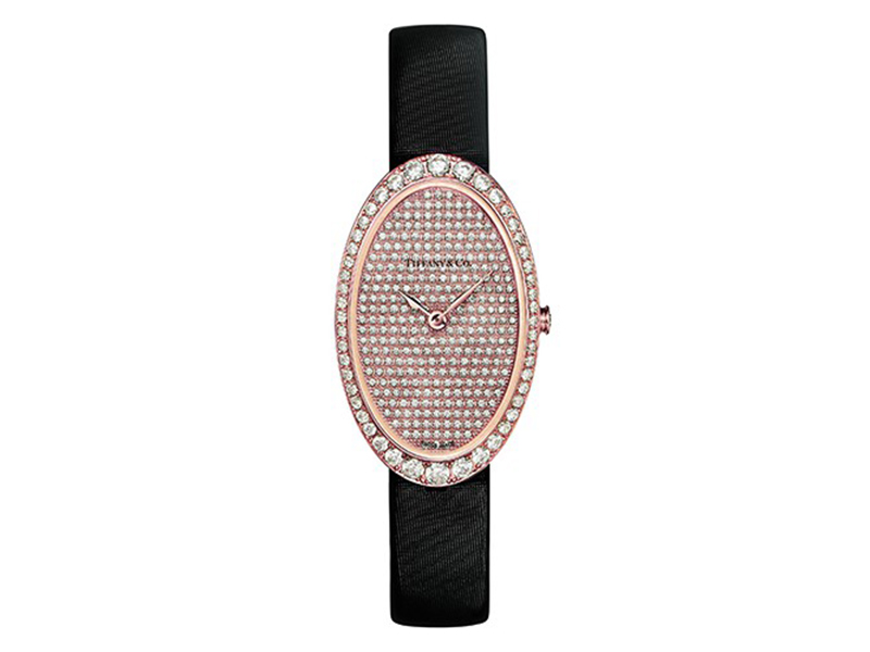 Tiffany & Co Watch in 18k rose gold. Pavé dial. On a black satin strap with a diamond buckle. 21x34 mm case set with round brilliant diamonds.