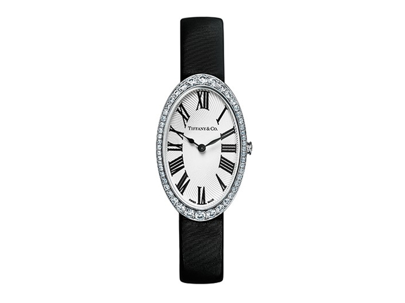 Tiffany & Co Watch in 18k white gold. White guilloché dial. On a black satin strap with a diamond buckle. 21x34 mm case set with round brilliant diamonds.