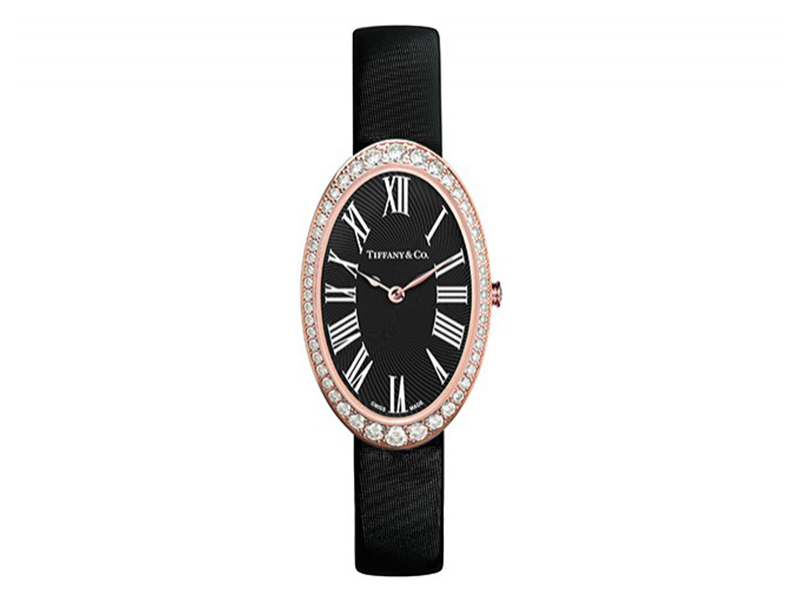 Tiffany & Co Watch in 18k rose gold. Black guilloché dial. On a black satin strap with a diamond buckle. 21x34 mm case set with round brilliant diamonds.