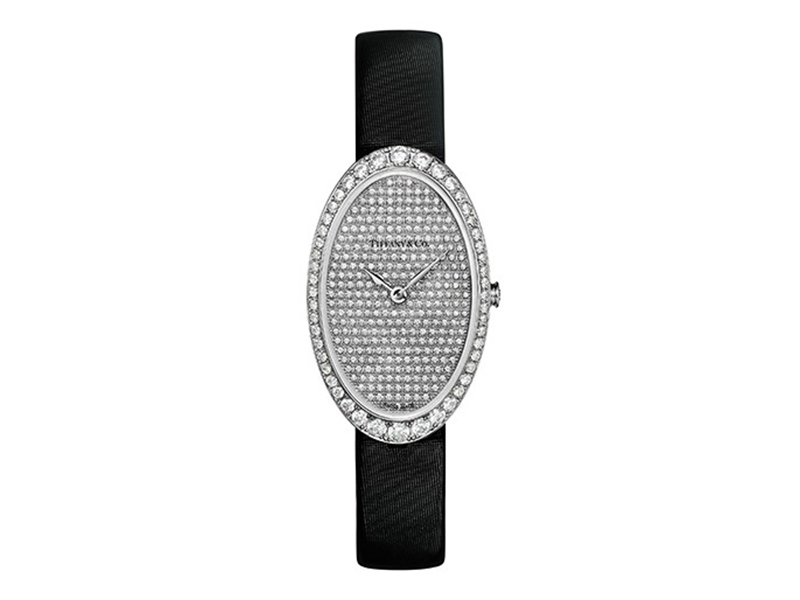 Tiffany & Co Watch in 18k white gold. Pavé dial. On a black satin strap with a diamond buckle. 21x34 mm case set with round brilliant diamonds.
