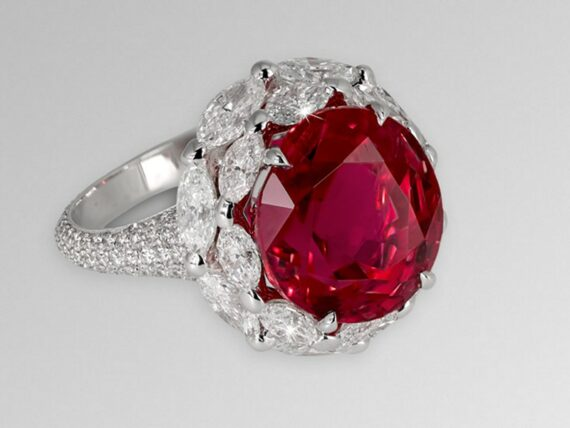 David Morris Natural Burma oval-cut ruby mounted with two row white marquise-cut diamond surround and micro-set white diamonds