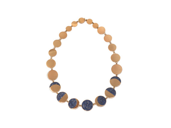 Pamela Love Moon Phase Collar mounted on yellow gold with pave blue sapphires