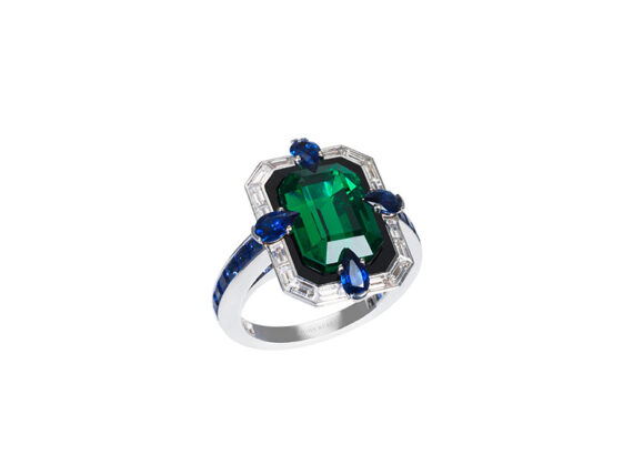 John Rubel Liberty Ring set with a 6.22 carat natural emerald, 16 baguette diamonds and 24 blue sapphires (no oil)