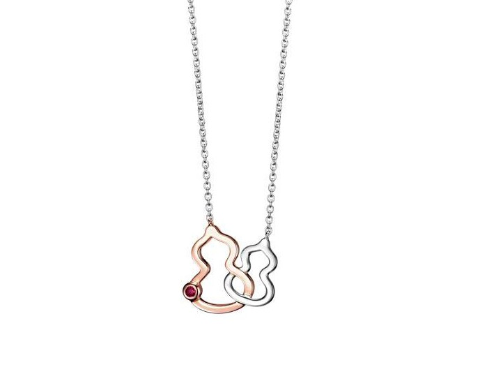 Qeelin Wulu necklace mounted on white and rose gold with ruby