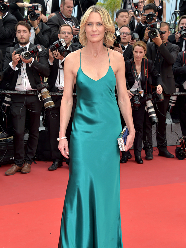 Cartier Robin Wright wore Panthère de Cartier bracelet and C de Cartier earrings. Cannes red carpet 2017